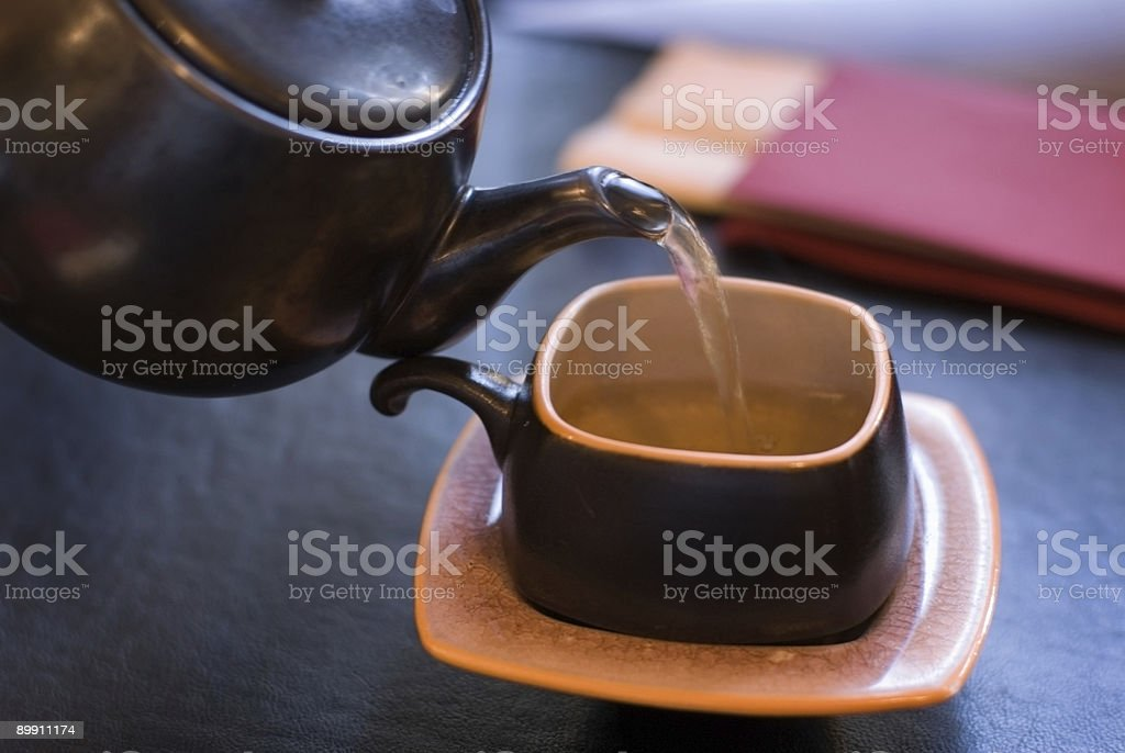Pouring green tea. royalty-free stock photo