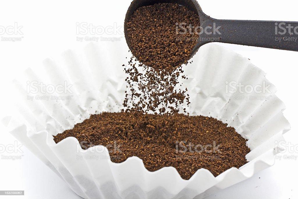 Pouring ground coffee stock photo