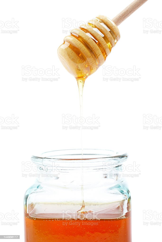 Pouring honey royalty-free stock photo