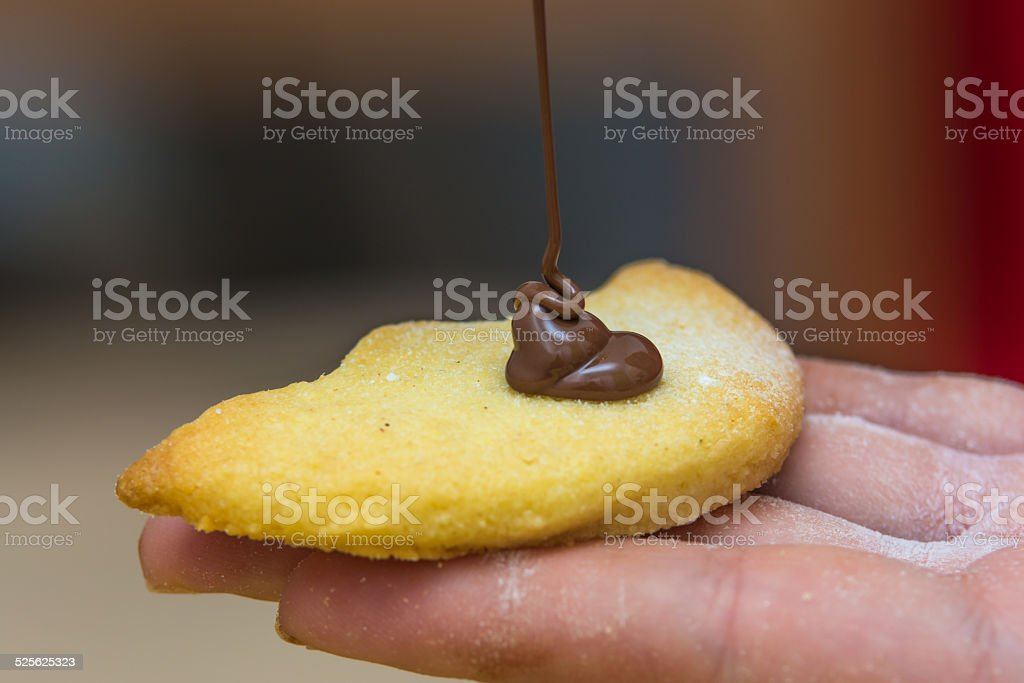 Pouring Hot Chocolate on a Cookie stock photo