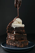 istock Pouring Hot Fudge On Brownies 1095069330