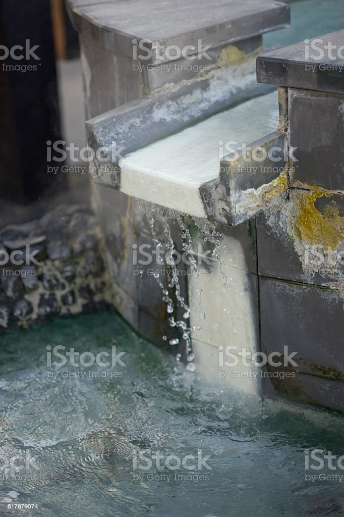 Pouring hot spring stock photo