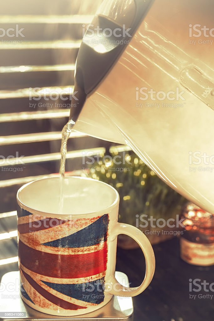 Pouring hot water in a coffee mug royalty-free stock photo