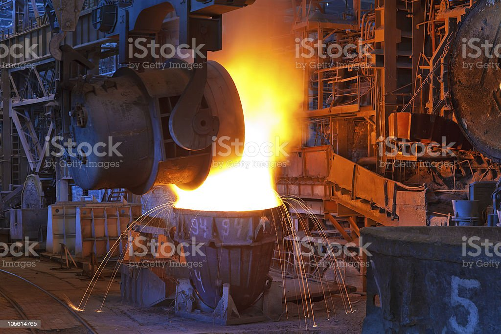 Pouring liquid metal at iron works stock photo