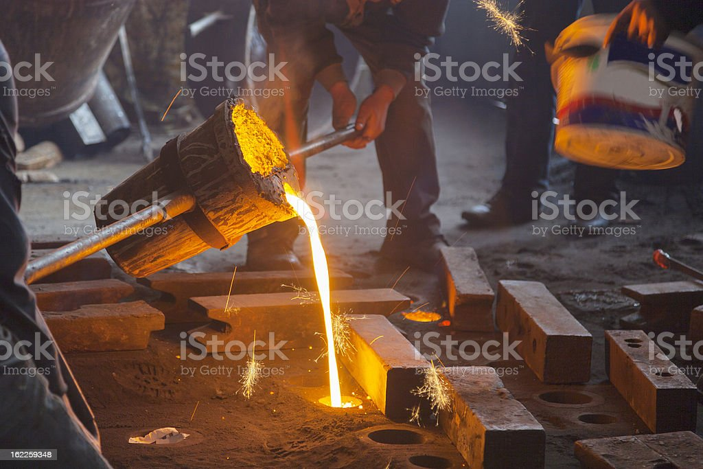 Pouring Metal royalty-free stock photo