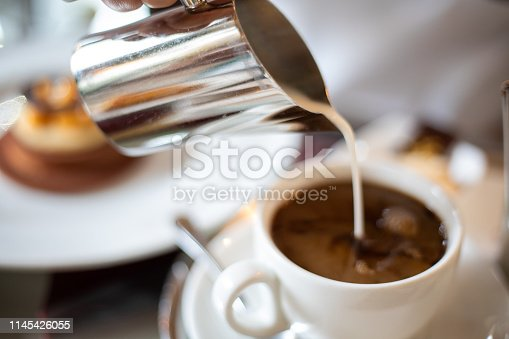 Pouring milk into filter coffee