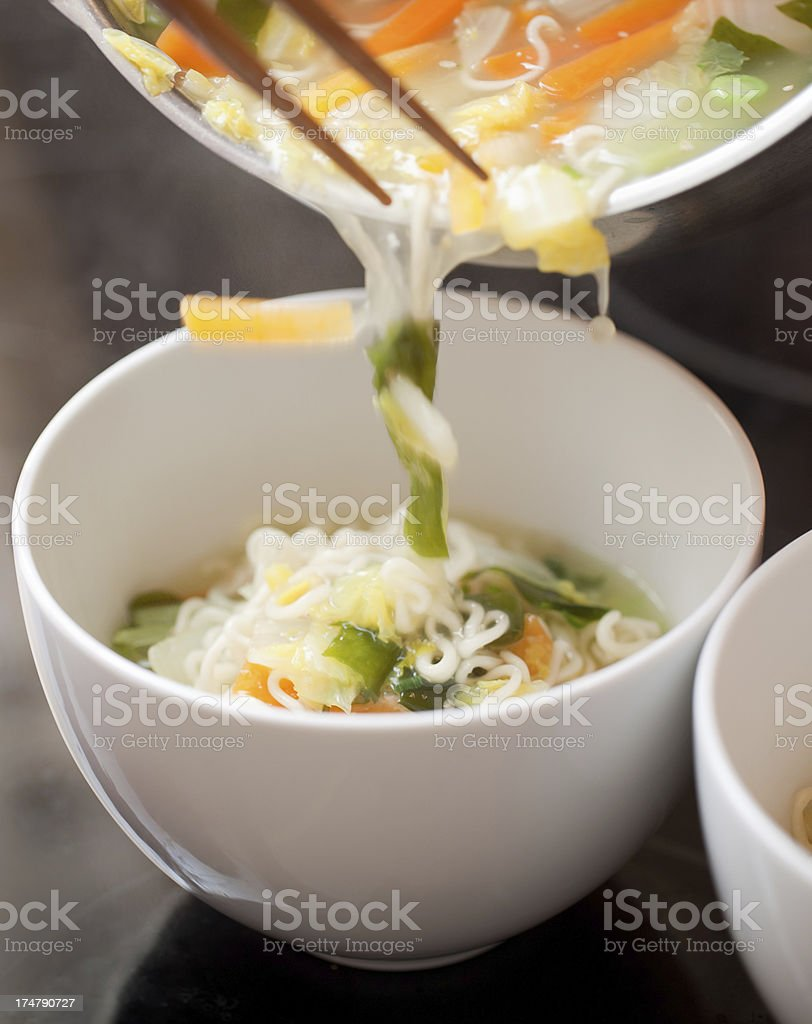Pouring noodle soup royalty-free stock photo