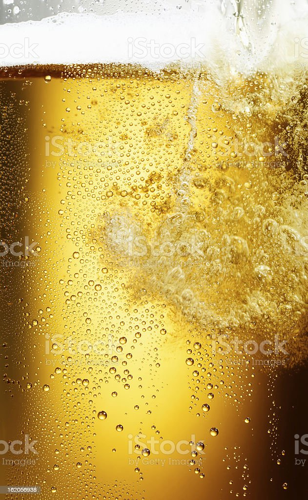 Pouring of beer stock photo