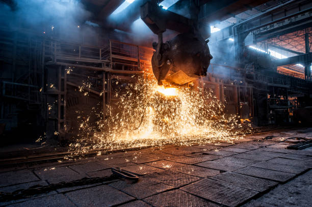 pouring of liquid metal in open-hearth furnace - steel stock photos and pictures