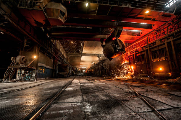 pouring of liquid metal in open-hearth furnace - metallurgy stock photos and pictures