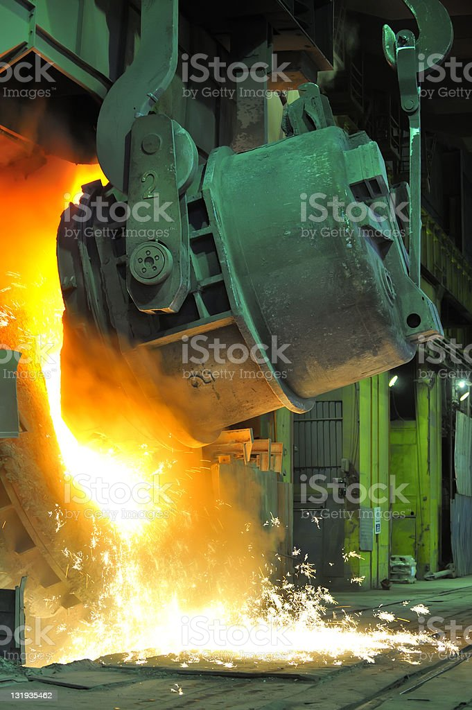 Pouring of liquid metal royalty-free stock photo