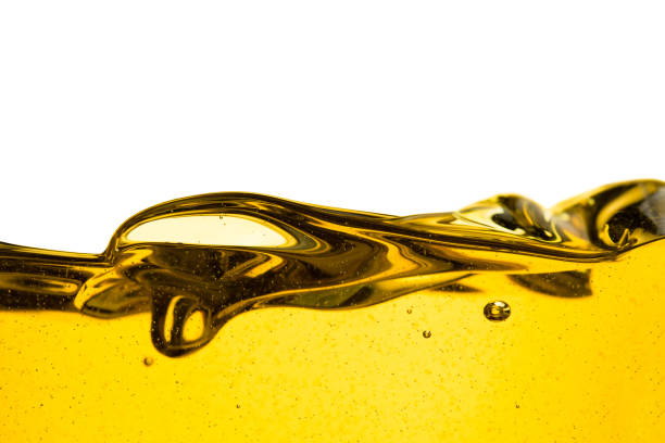pouring oil car motor or olive vegetable cooking and bubble isolated on white background - benzina foto e immagini stock