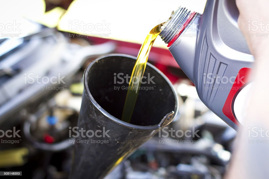Pouring Oil into Car stock photo