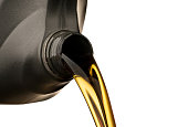 istock Pouring oil lubricant motor car from black bottle on isolated white background 960140432
