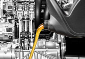istock Pouring oil lubricant motor car from bottle on engine background 937839808