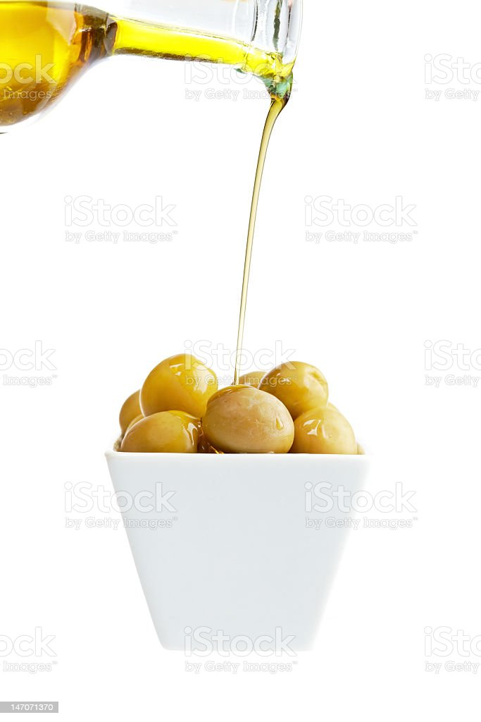 Pouring olive oil stock photo