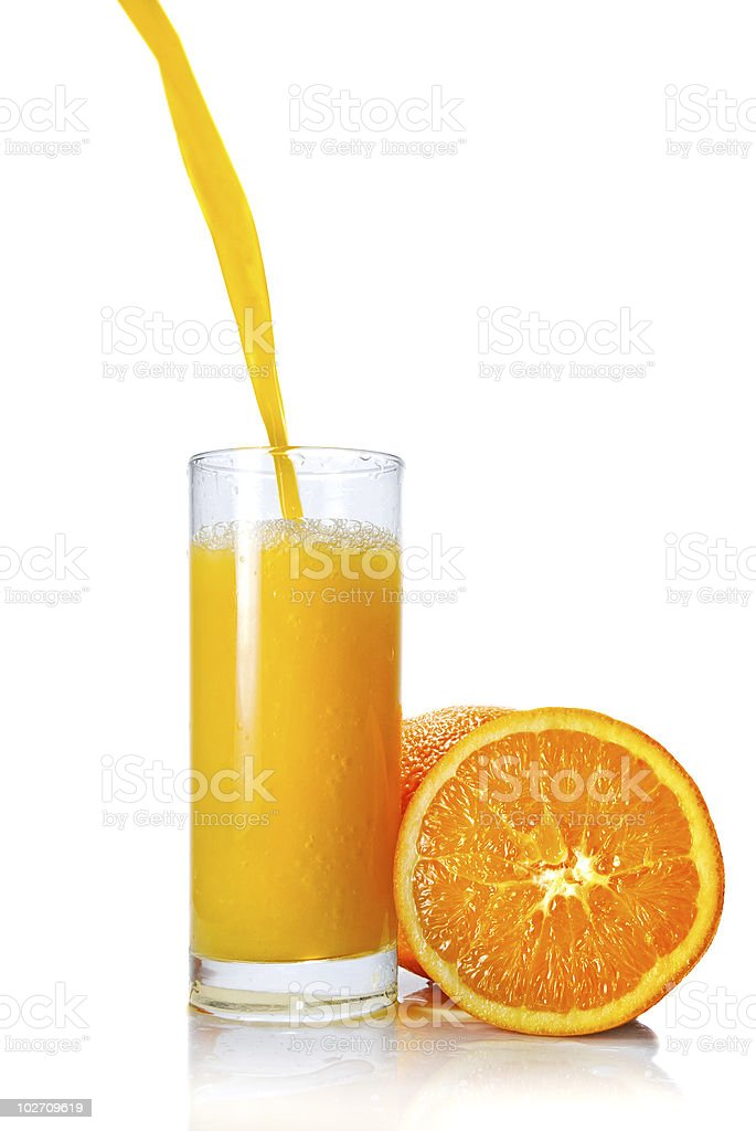 Pouring orange juice in glass stock photo