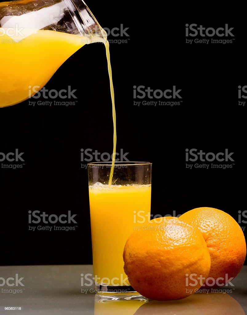 Pouring Orange Juice royalty-free stock photo