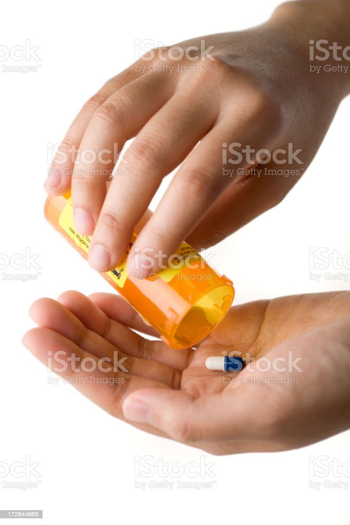 Pouring Pill into Hand royalty-free stock photo
