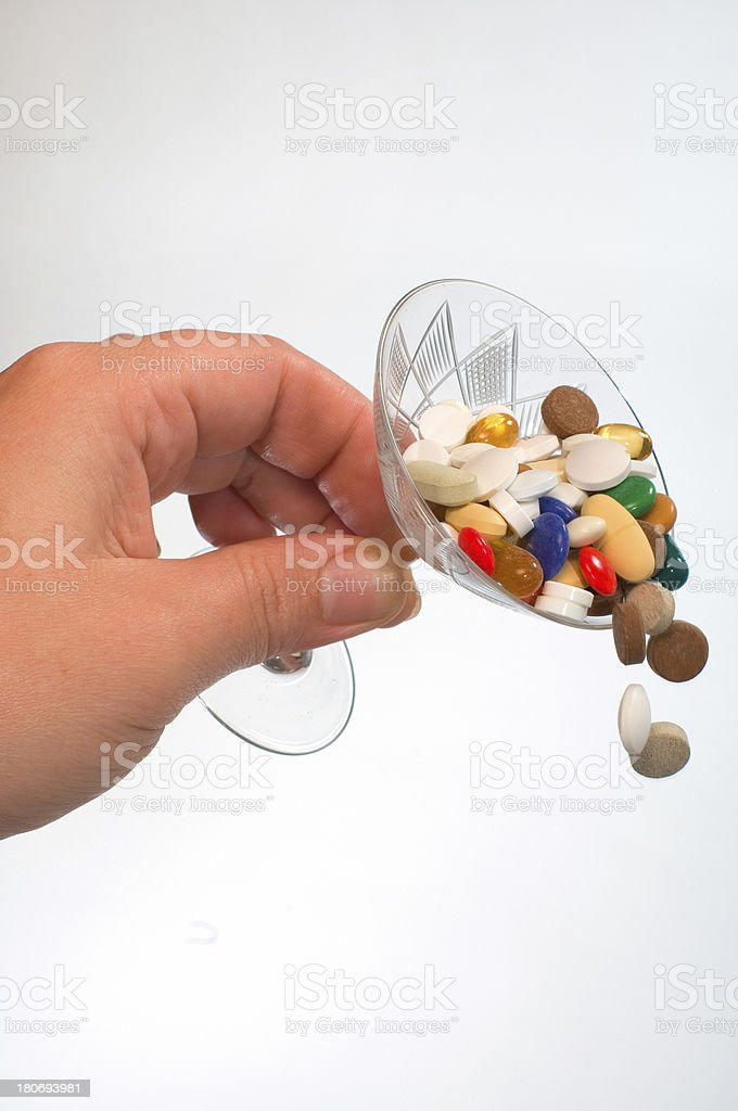 pouring pills... stock photo