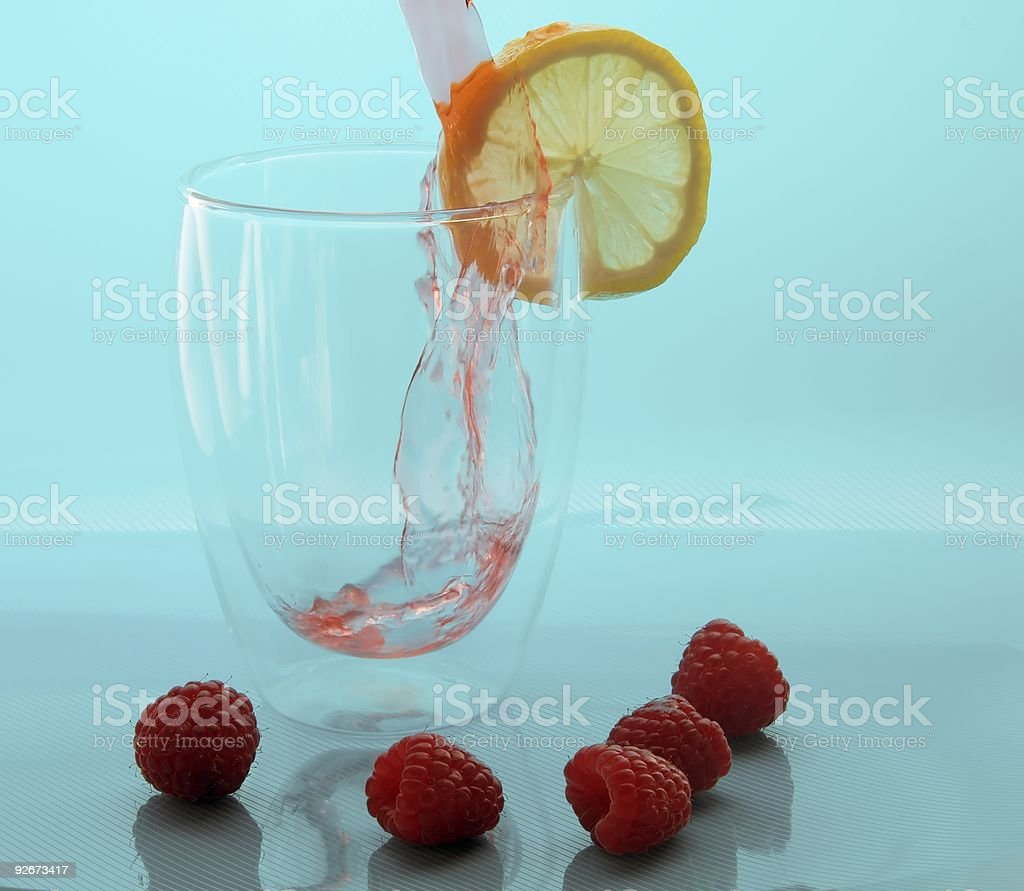 Pouring Raspberry Lemonade stock photo