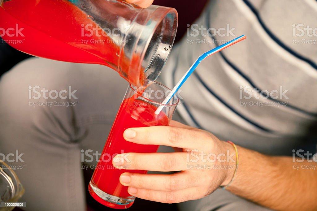 Pouring red orange juice royalty-free stock photo