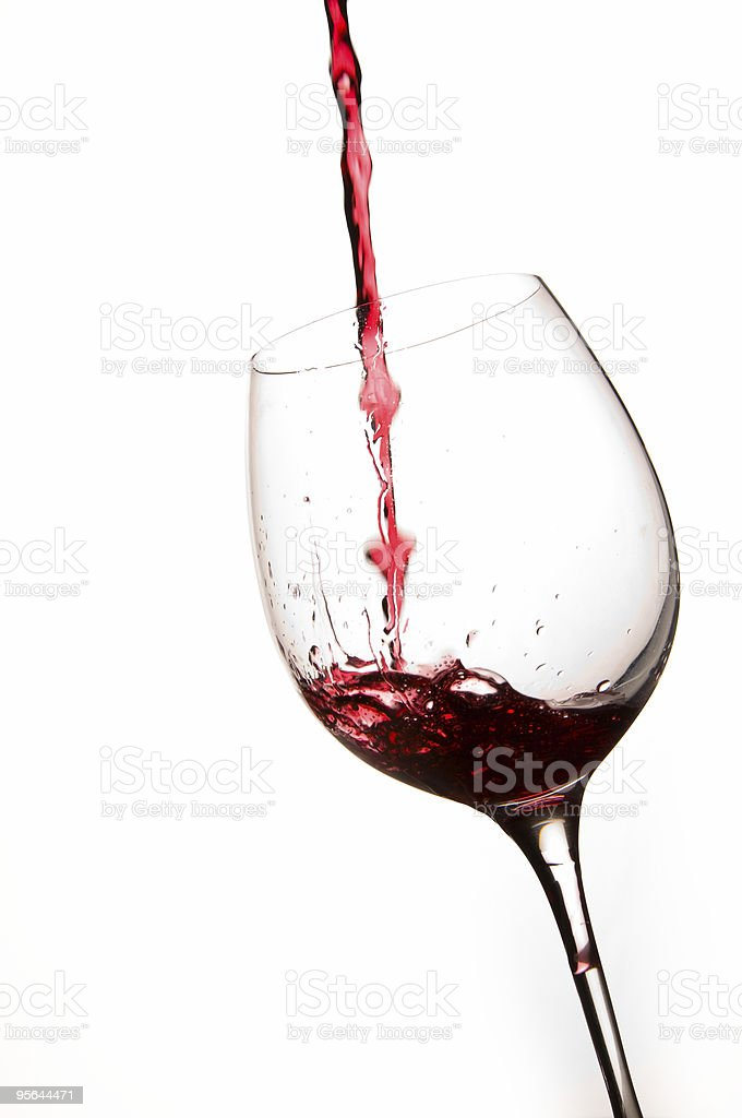 Pouring Red Wine in a Glass royalty-free stock photo