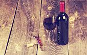Used cork wine cap on light brown background.
