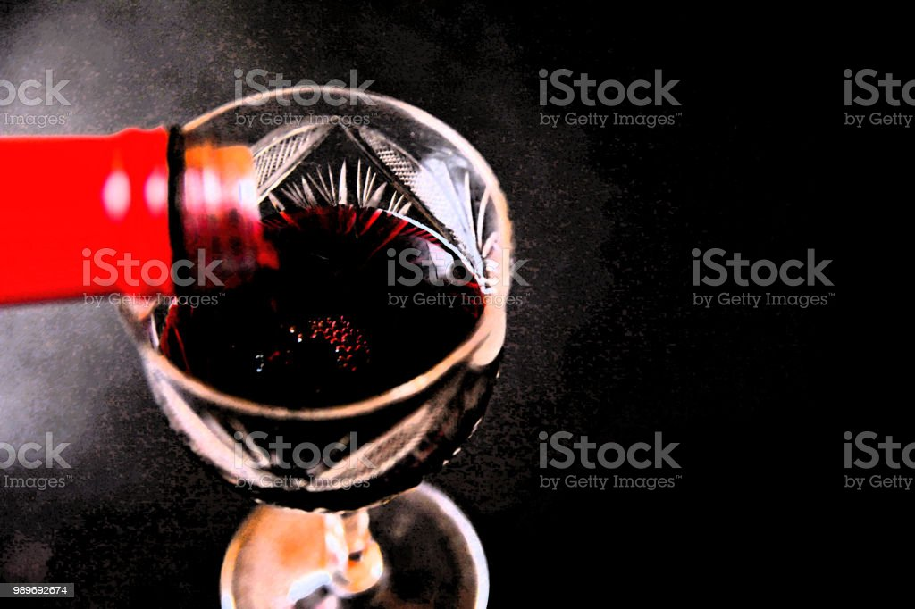 Pouring red wine into the glass effective stock photo