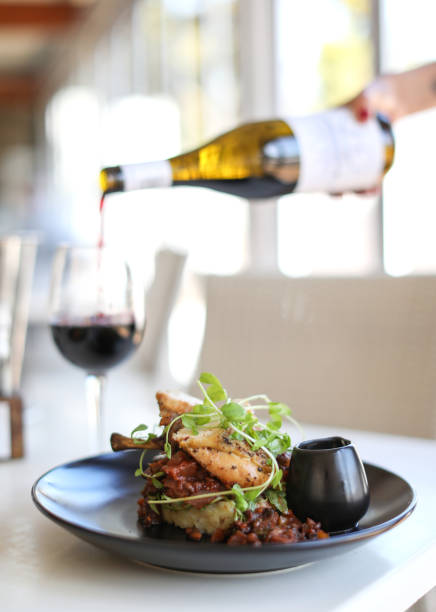 Pouring red wine. Restaurant food gourmet stock pictures, royalty-free photos & images