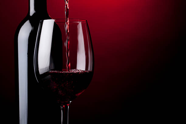 pouring red wine - wine glass stock photos and pictures