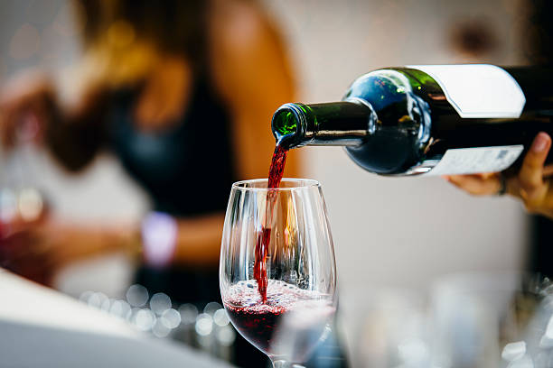 Pouring red wine. stock photo