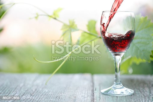 619246768 istock photo Pouring Red Wine 860317856
