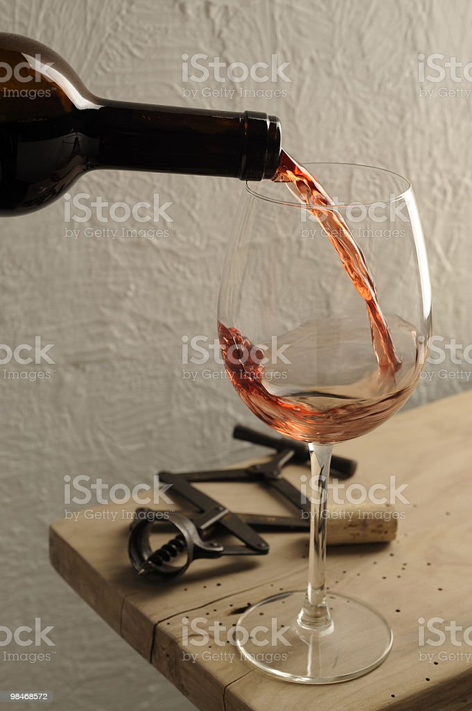 Pouring red wine. royalty-free stock photo