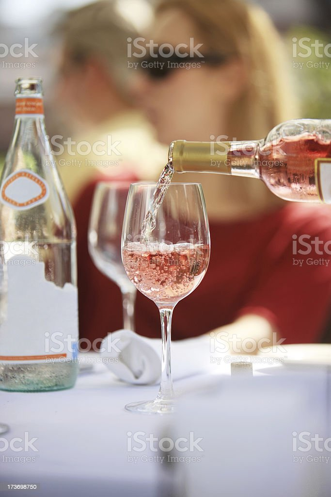 Pouring Rose Wine royalty-free stock photo
