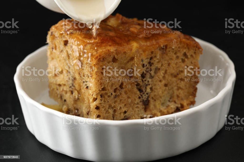 Pouring Rum Onto A Slice Of English Fruit Cake stock photo