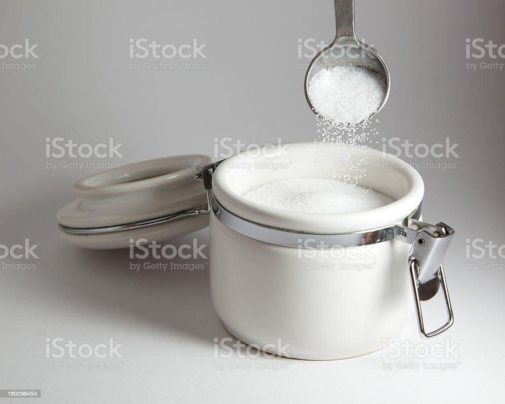 Pouring salt stock photo