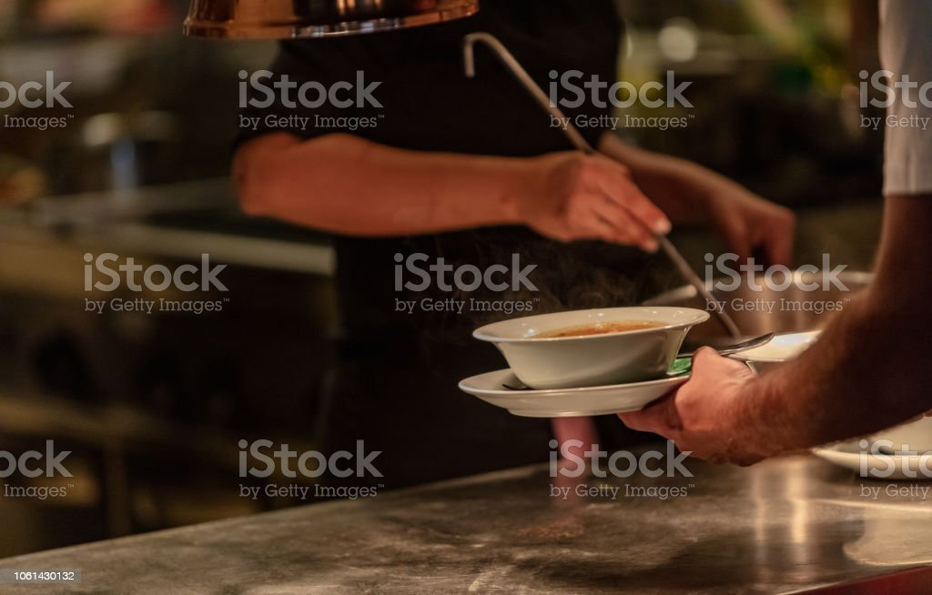 Pouring soup stock photo