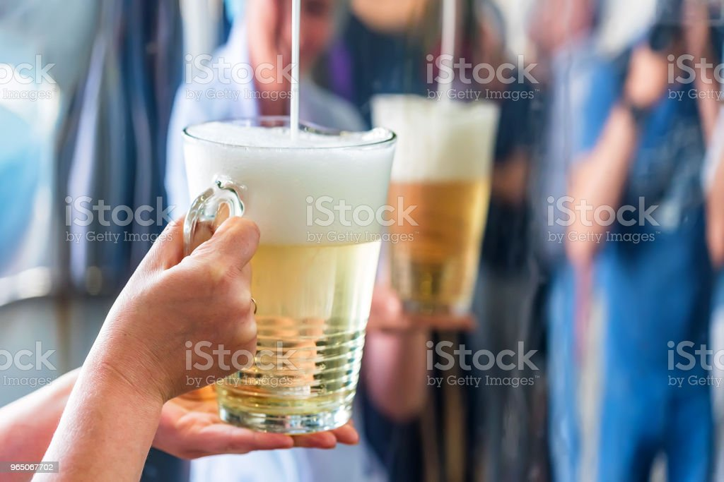 Pouring sparkling wine in glass at winery royalty-free stock photo