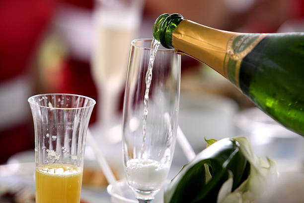 pouring sparkling wine stock photo