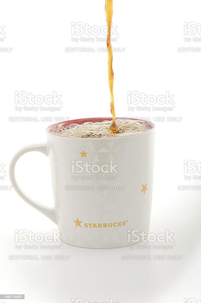 Pouring Starbucks Coffee royalty-free stock photo
