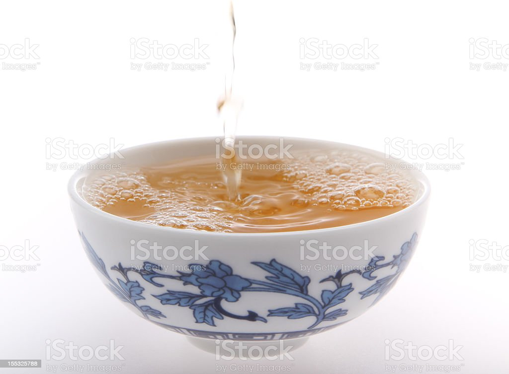 Pouring Tea into cup stock photo