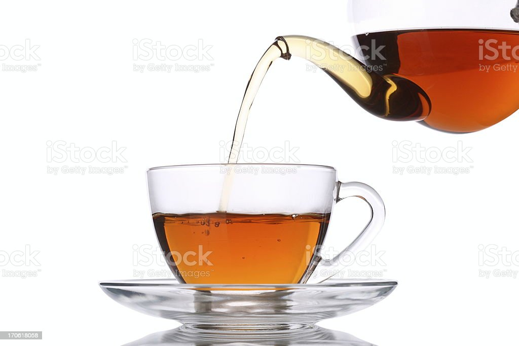 Pouring Tea into Glass Cup stock photo