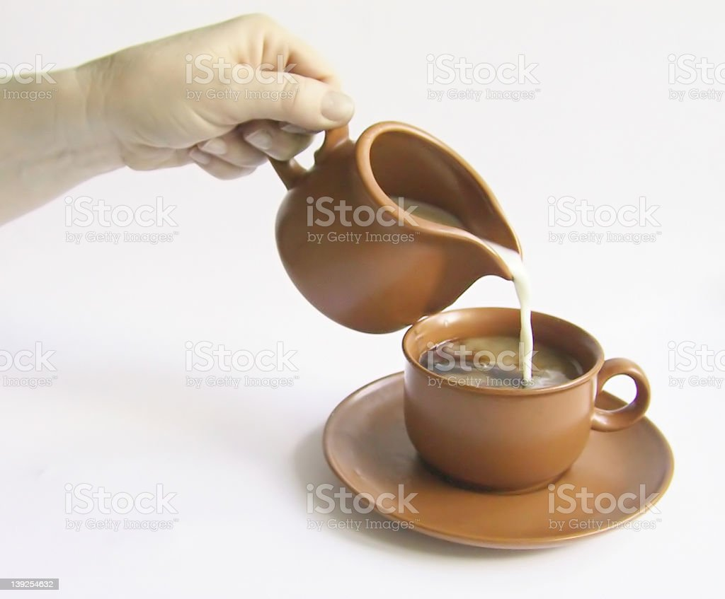 Pouring the milk royalty-free stock photo