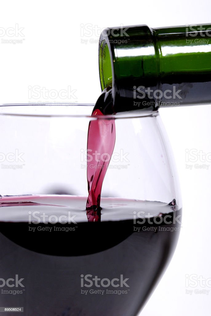 Pouring the wine royalty-free stock photo