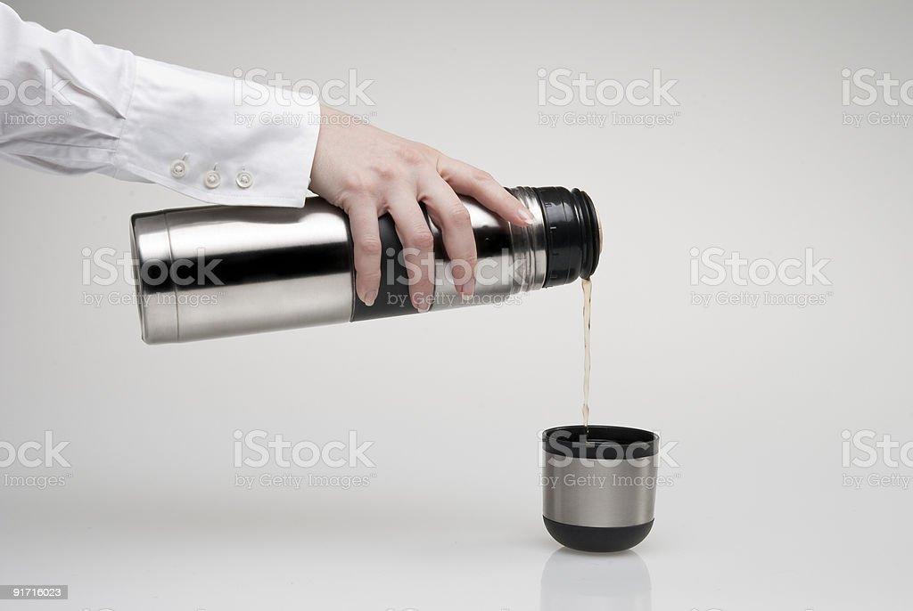 pouring thermos' mug stock photo
