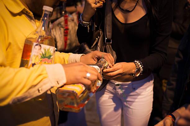 pouring traditional drink in oaxaca, mexico - mezcal fotografías e imágenes de stock
