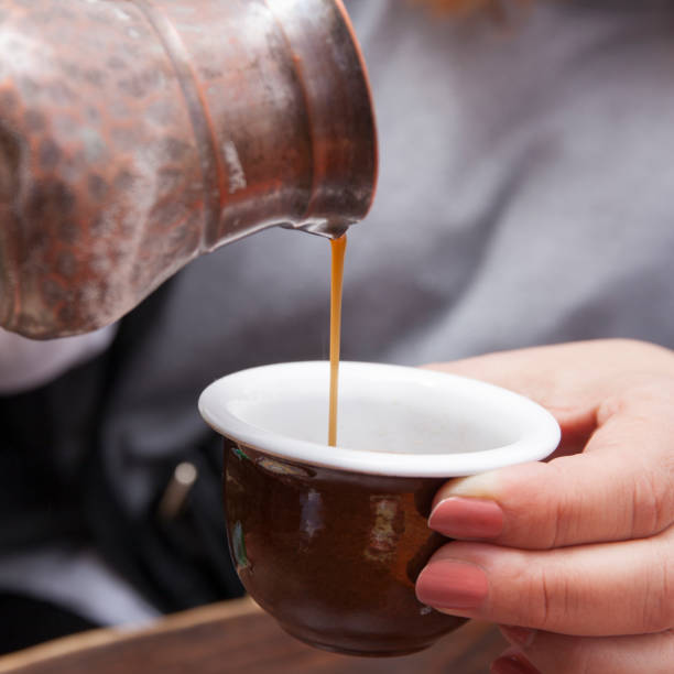 Pouring Turkish Coffee in a Coffee Shop stock photo