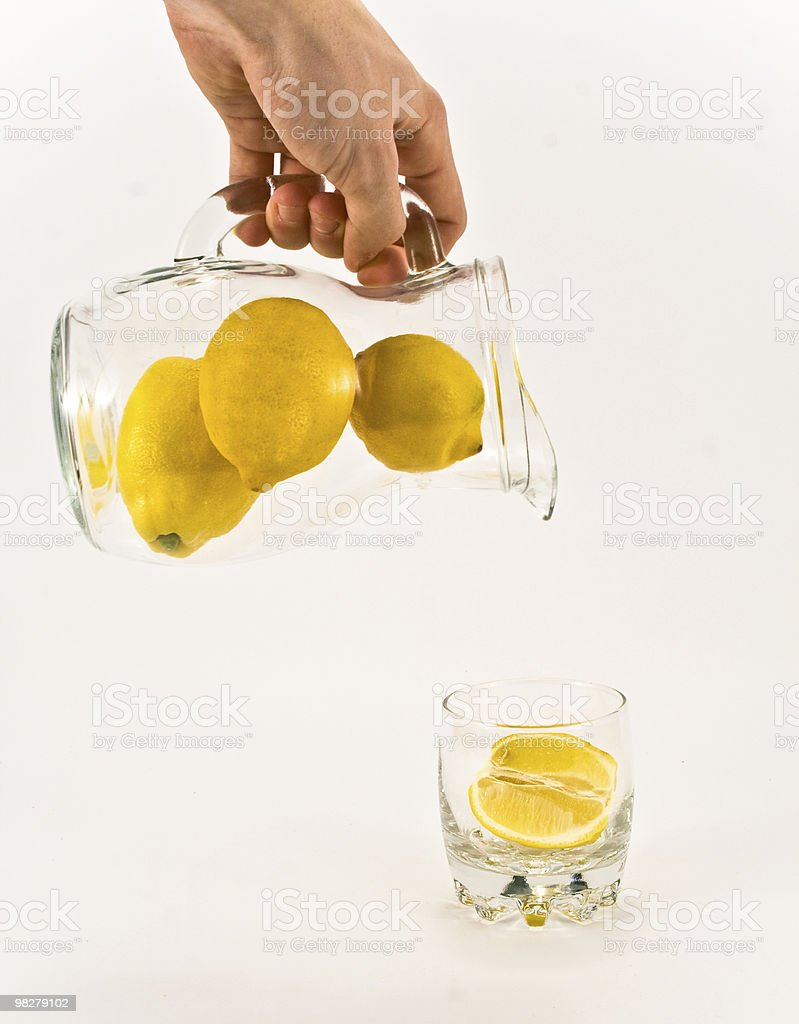 Pouring unsqueezed lemonade royalty-free stock photo