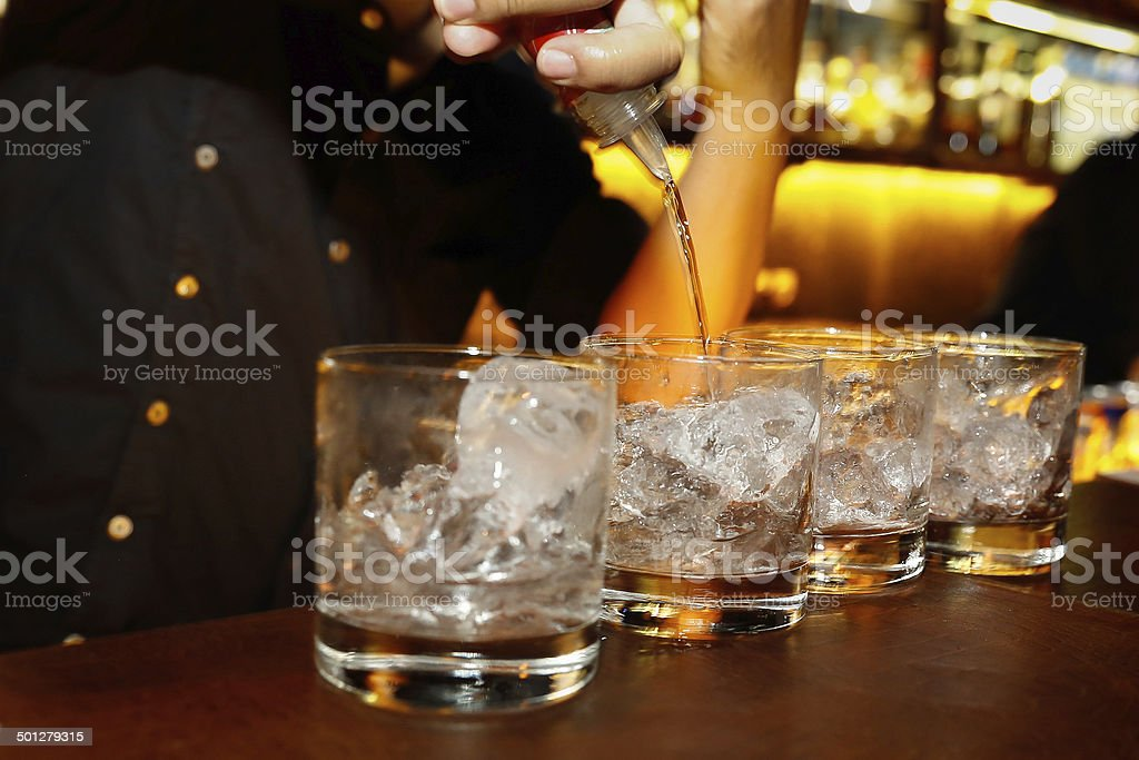 Pouring vodka stock photo